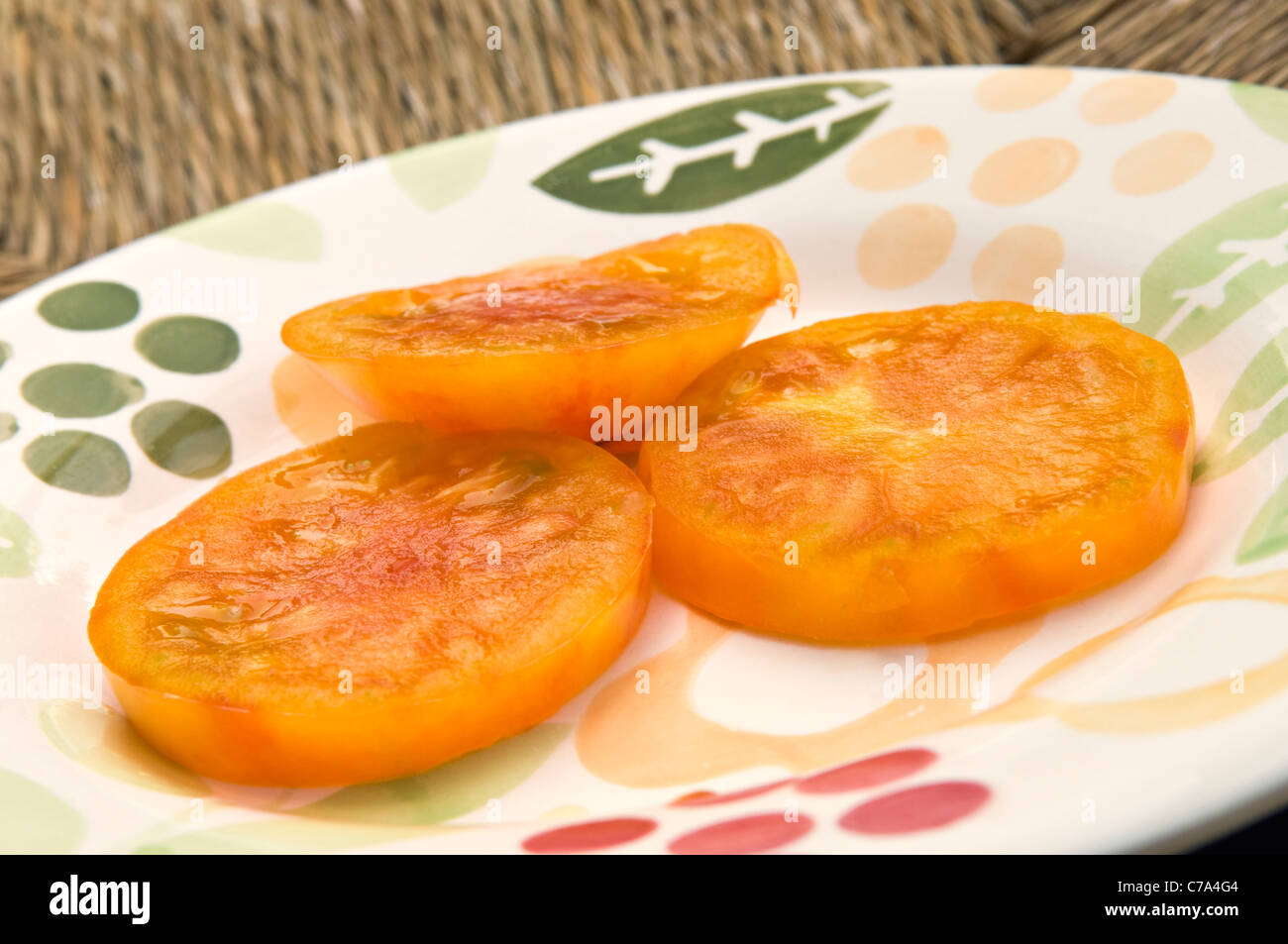 Slices of Old German Heirloom Tomato - Stock Image