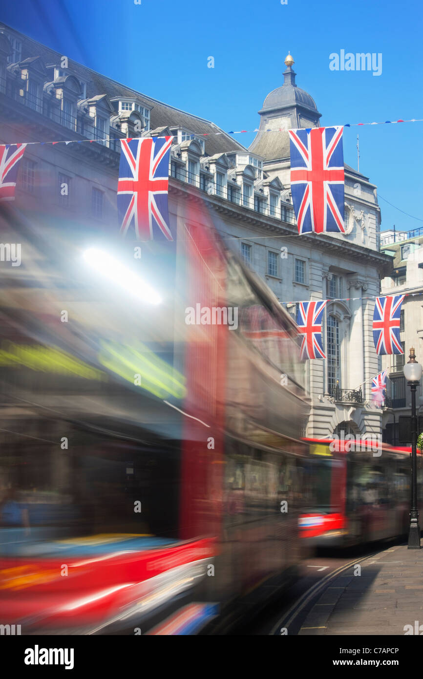 Red buses and Union Jack Flags on Regent Street; London; England - Stock Image