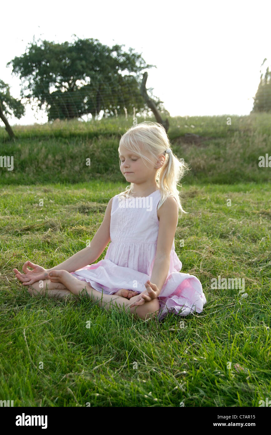 Portrait of a girl practicing yoga in summer, Eyendorf, Lower Saxony, Germany, Europe - Stock Image