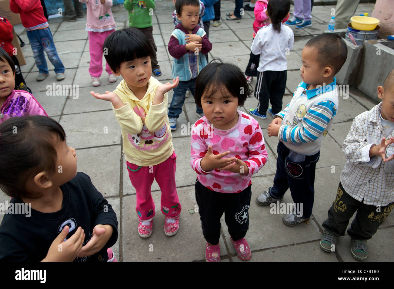 Children of migrant workers play at a kindergarten on outskirts of Beijing, China. 16-Sep-2011 - Stock Image