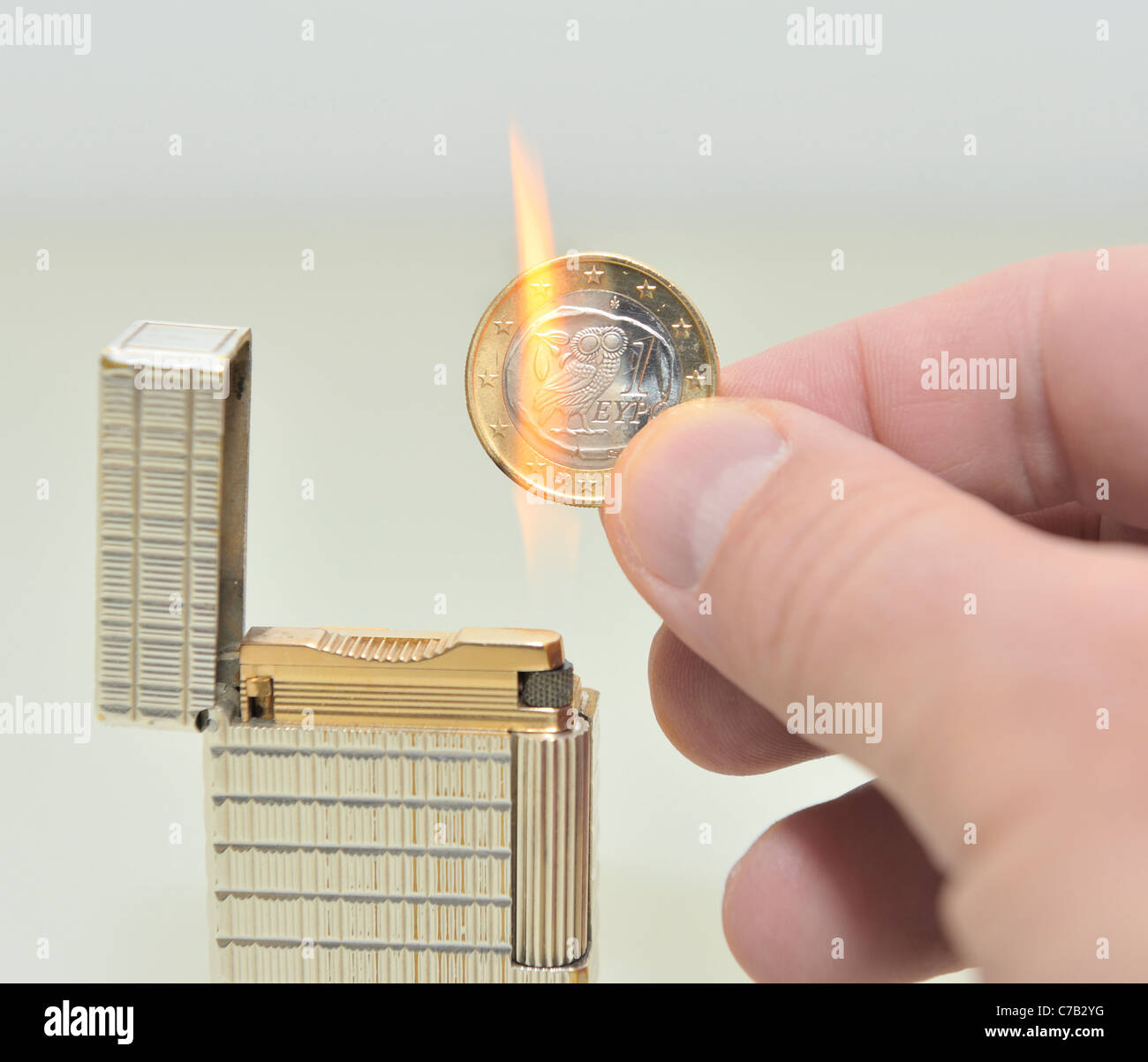 Greek Euro Coin Burning - Stock Image