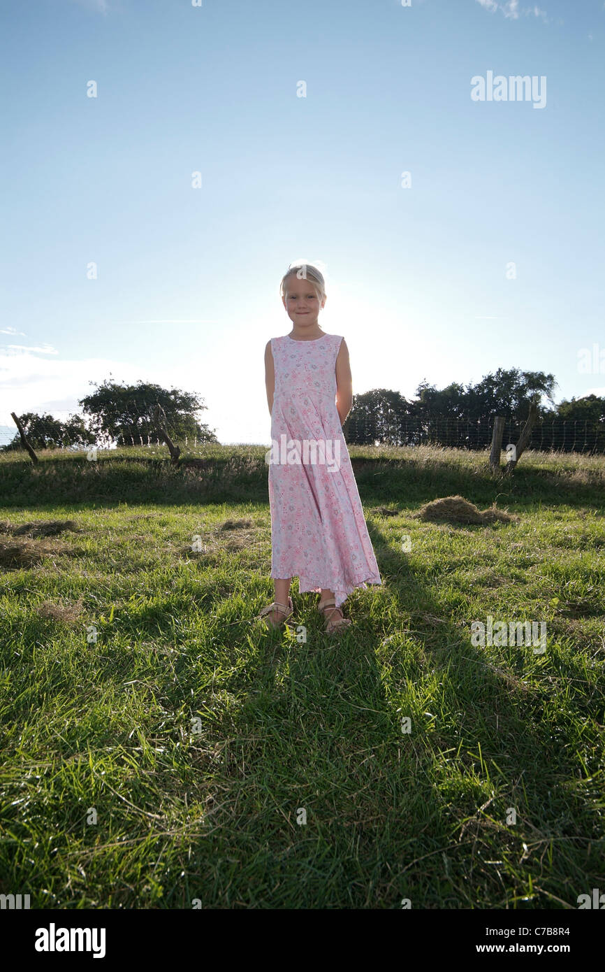 Portrait of a girl standing on a meadow in summer, Eyendorf, Lower Saxony, Germany, Europe - Stock Image