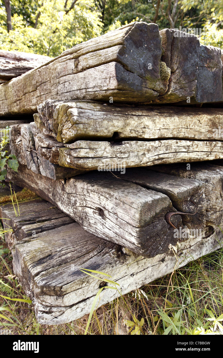 A pile of old, used, wooden railway sleepers. - Stock Image