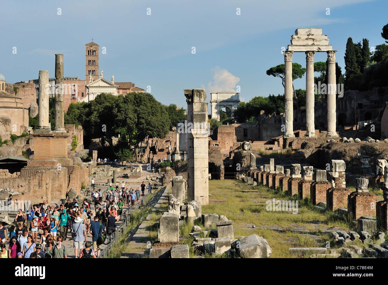 Rome. Italy. Tourists visiting the Roman Forum (Foro Romano). - Stock Image