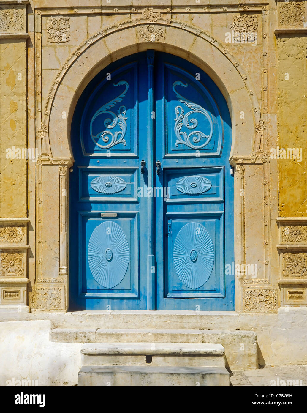 Sidi Bou Said, Tunisia, North Africa, traditional arched doorway with blue doors, - Stock Image
