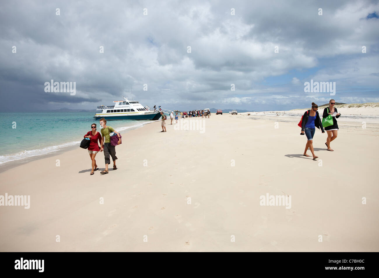 Tourists after arrival on Long beach southern Great Keppel Island Great Barrier Reef Marine Park UNESCO World Heritage - Stock Image