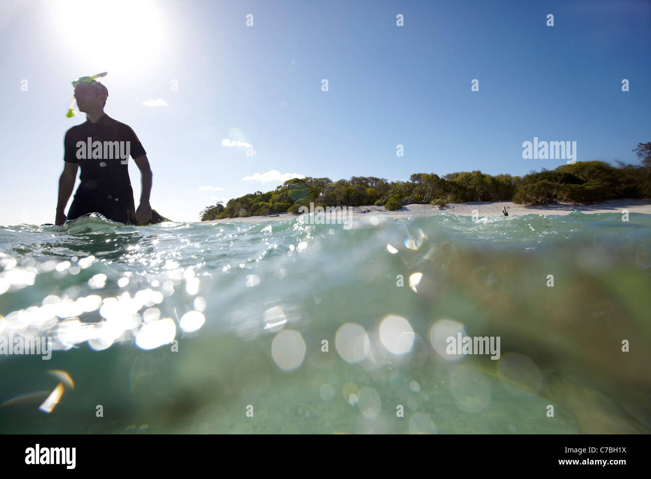 Snorkeler near Heron Island eastern part is part of the Capricornia Cays National Park Great Barrier Reef Marine Stock Photo