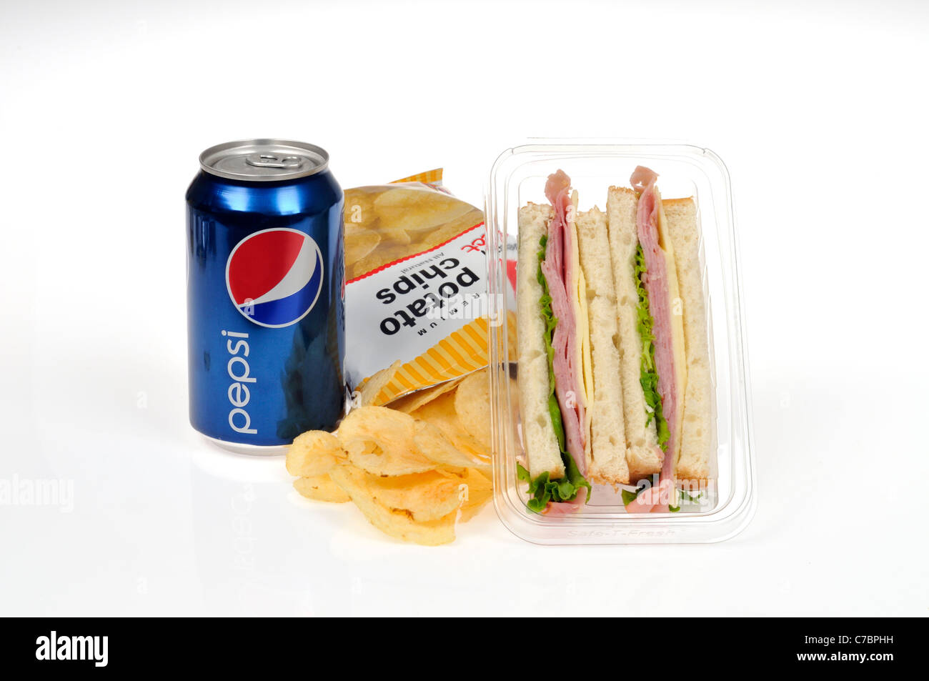 Ham and cheese with lettuce takeaway pre-made sandwich on white bread in plastic packet container with potato chips - Stock Image
