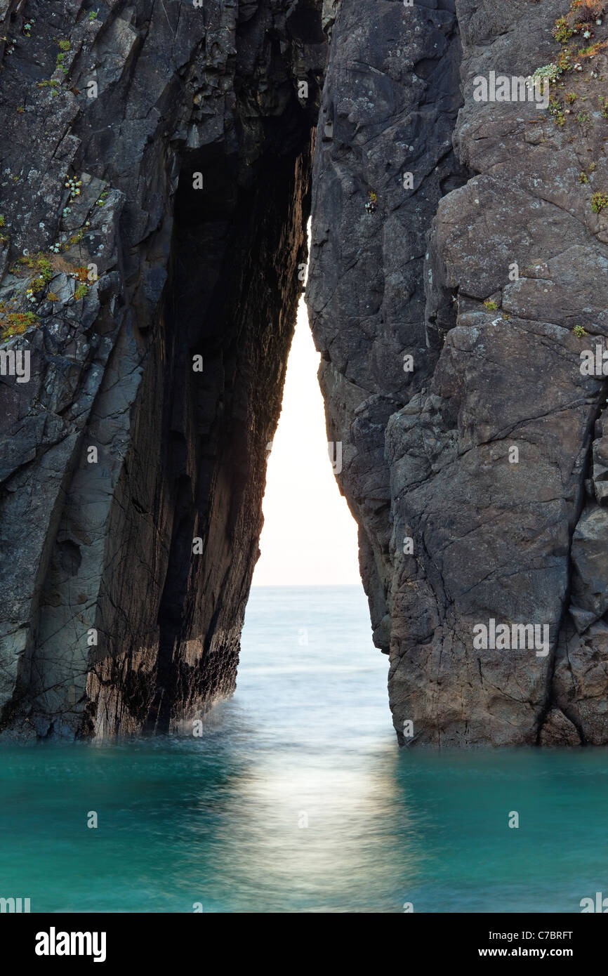 Triangular passage in sea stack, Harris Beach State Park, Brookings, Oregon, USA, North America - Stock Image