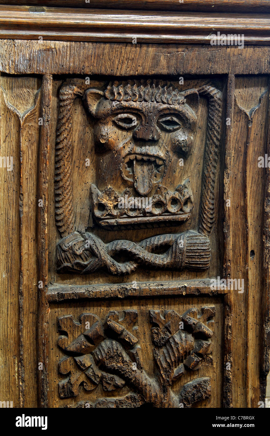 Medieval carved bench end, St. Leonard`s Church, Misterton, Leicestershire, England, UK Stock Photo