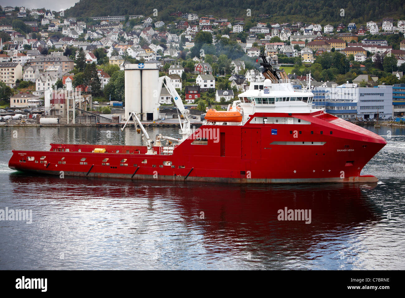 Anchor Handler and Construction Vessel, Skandi Vega, sails out of the Port of Bergen, Norway. - Stock Image