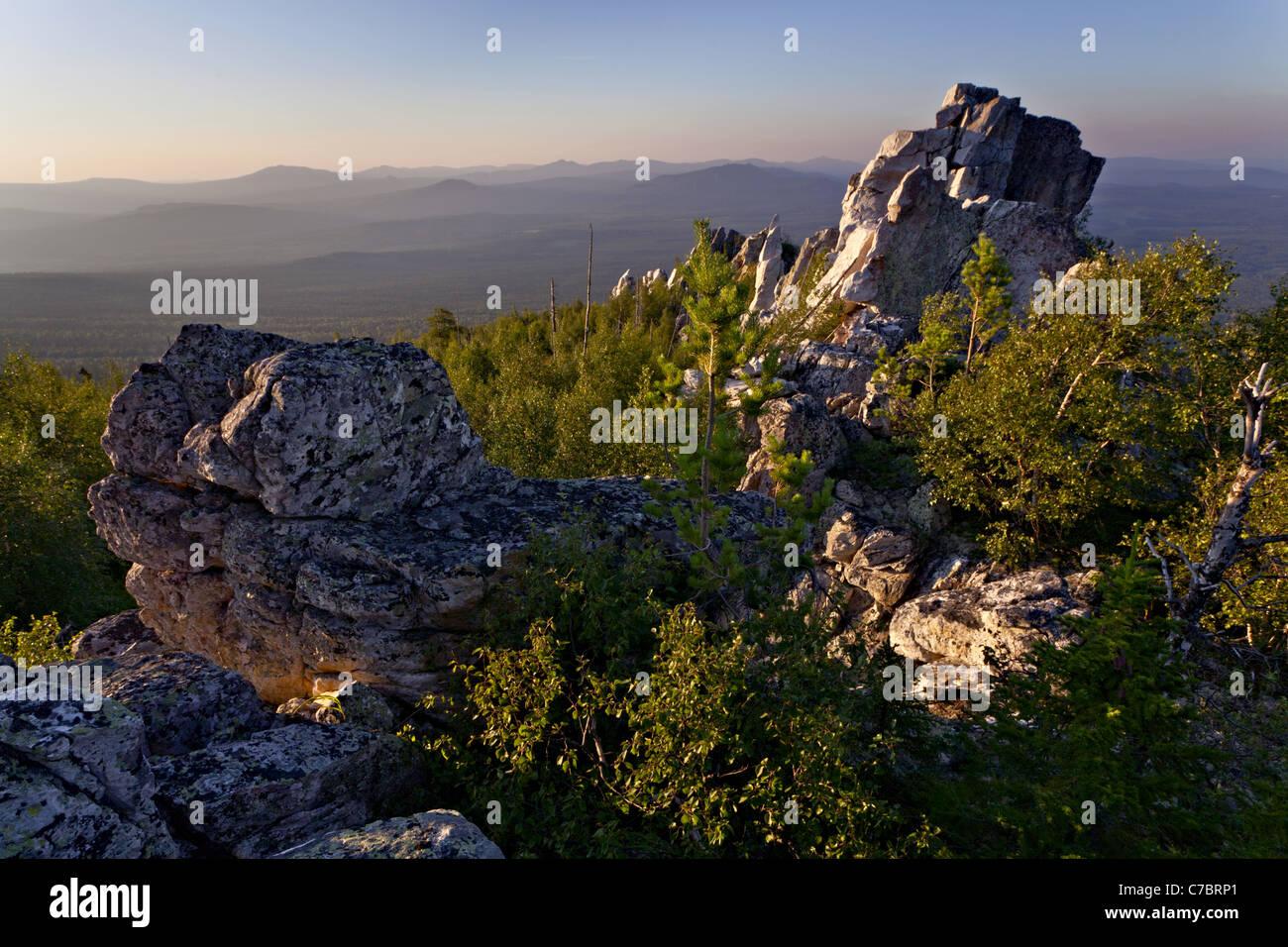 Rocks in sunset illimination, Urals, Russia - Stock Image