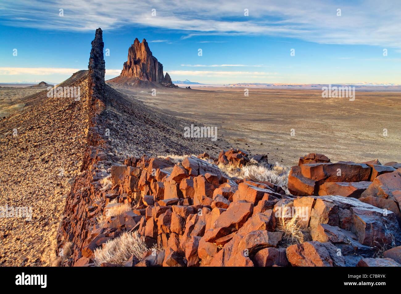 Shiprock Rock and black dike ridge, New Mexico, USA Stock Photo
