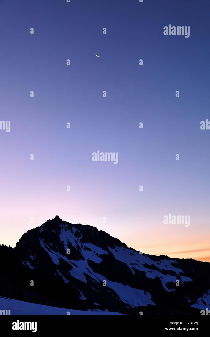 Moon above Buckner Mountain from Sahale Arm, North Cascades National Park, Washington State, USA - Stock Image
