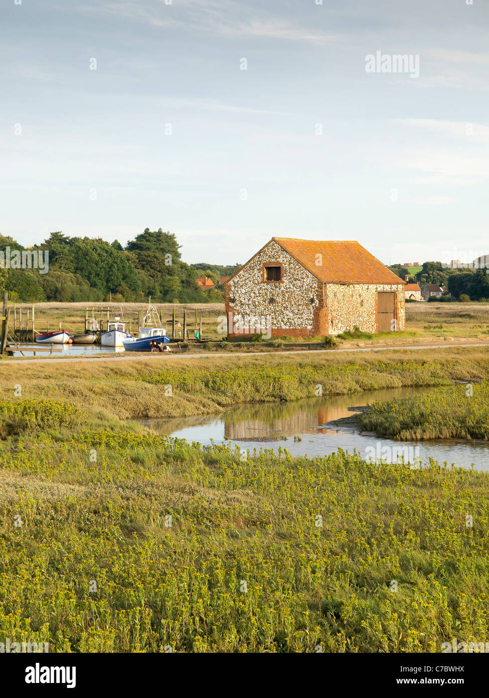 Thornham Village with the Old Coal Barn seen from the Holme Nature Reserve Norfolk in evening light - Stock Image