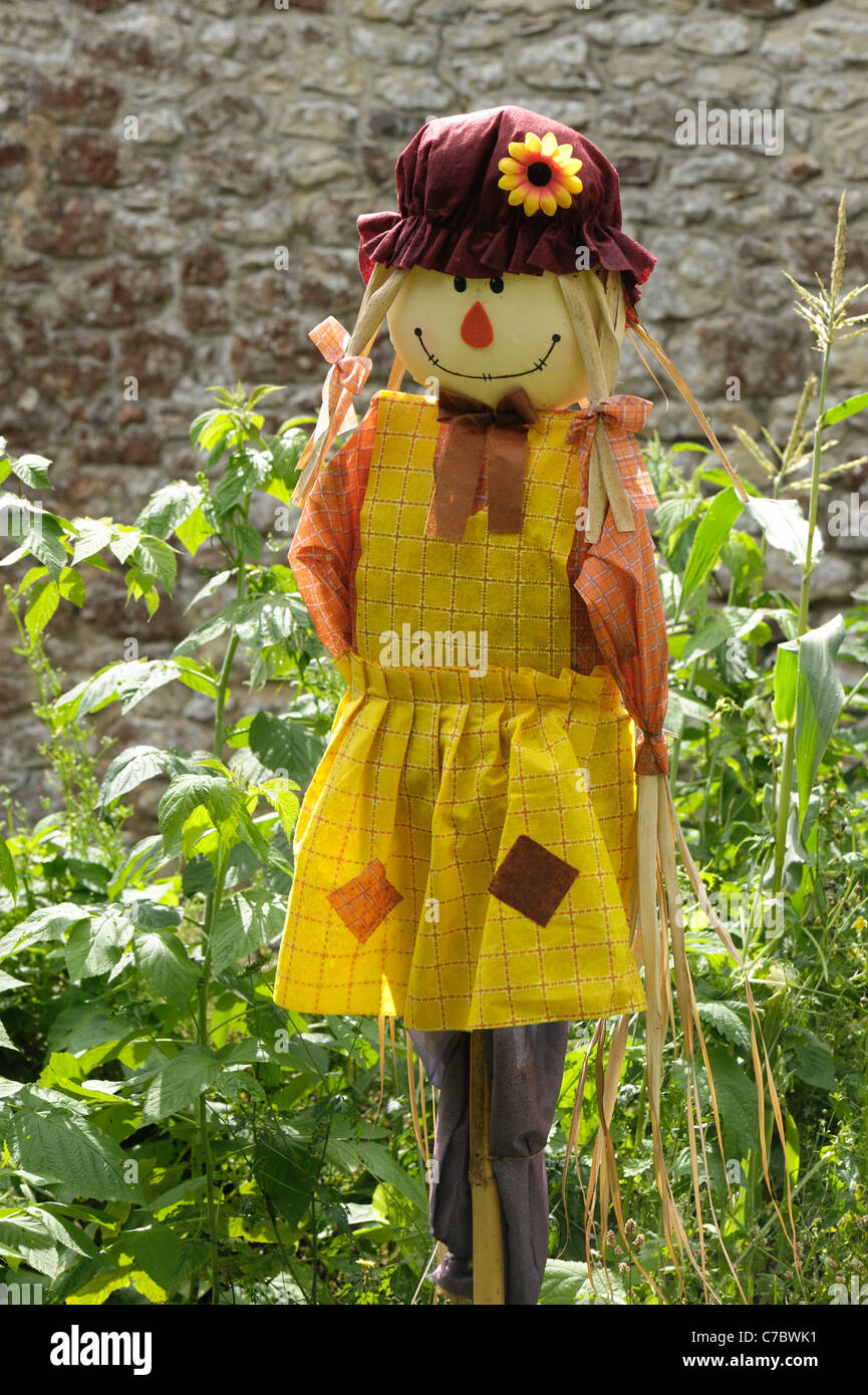 Female lady scarecrow sold for use on allotments, vegetable and fruit gardens - Stock Image