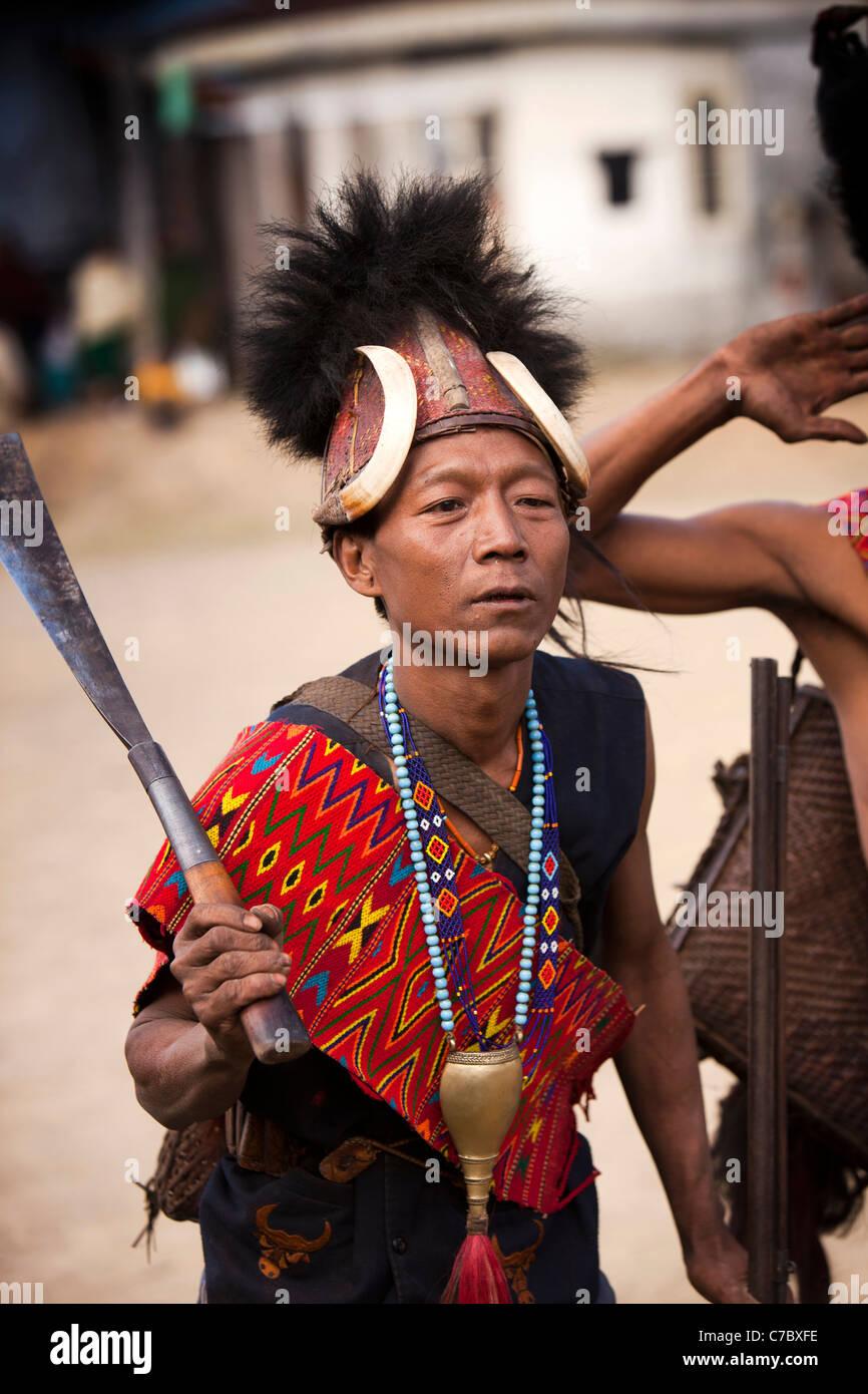 India; Nagaland; Longwa; Konyak Naga warriors in traditional dress carrying battle knife - Stock Image