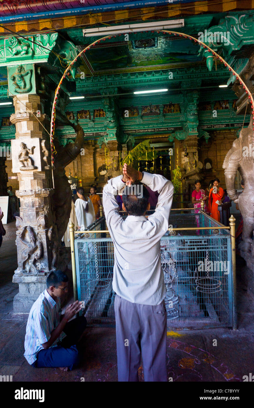 Aman praying at the Meenakshi Amman temple in Madurai, Tamil Nadu, India. Stock Photo
