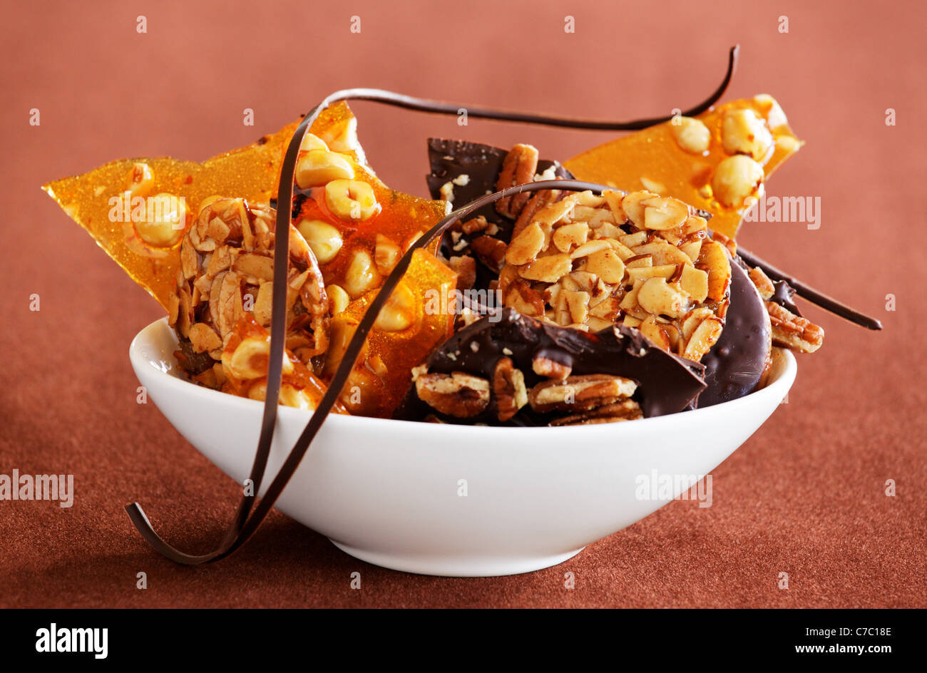 Hazelnut brittle, almond Florentines and chocolate pecan bark with chocolate garnish by pastry chef Laurie Pfalzer, - Stock Image