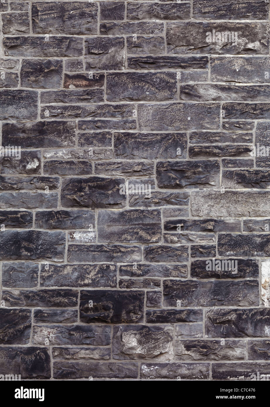 Old gothic architecture style stone wall texture background. High quality high resolution photo. - Stock Image