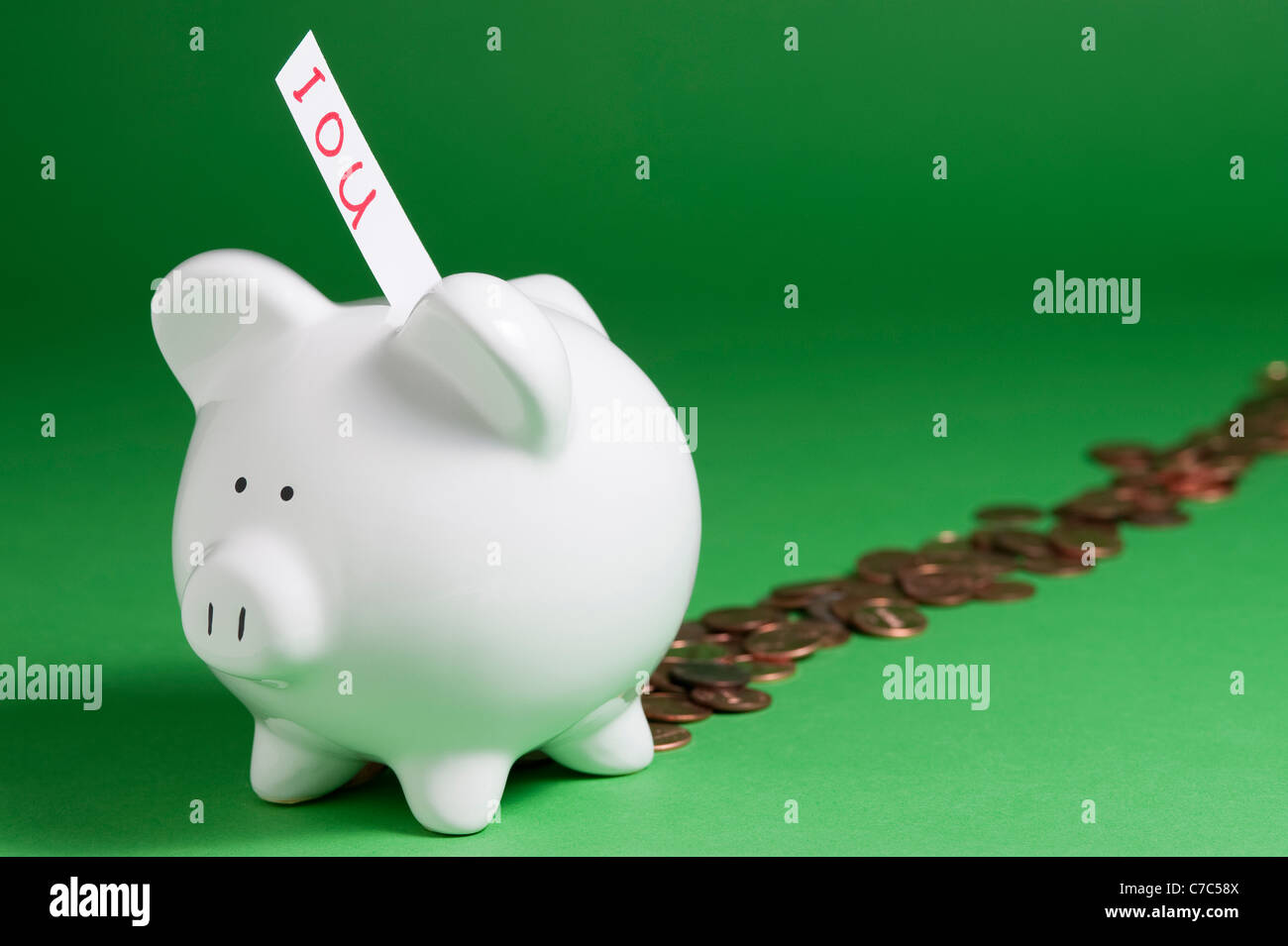 Group of pigs with IOU's coming out of coin slots and pennies coming out back - Stock Image