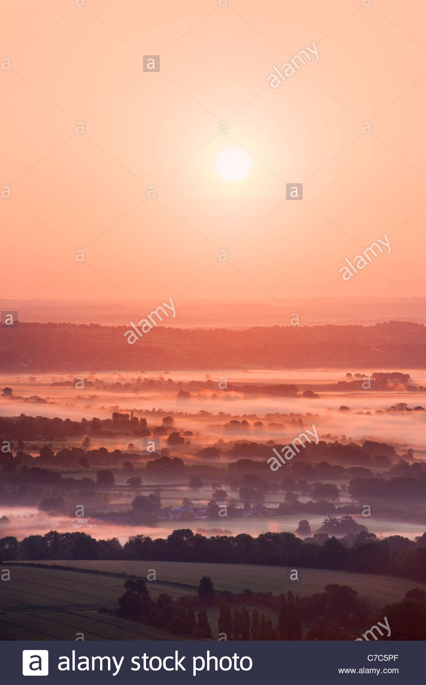 Morning mist in the South Downs National Park, from Bignor Hill, Sussex, England - Stock Image