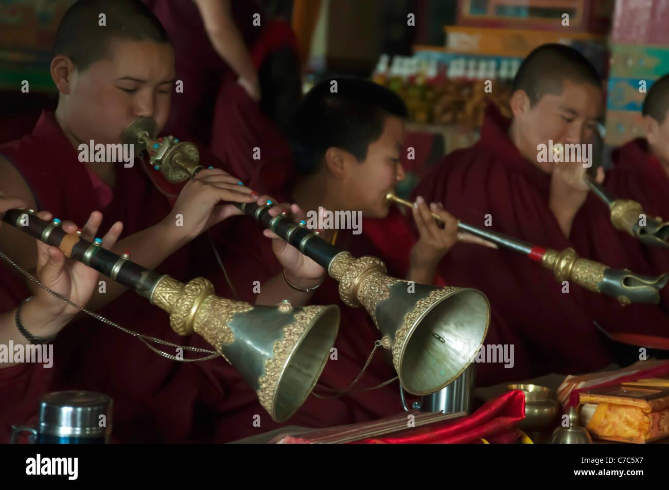 Sherpa Buddhist monks performing ceremonies at the Ani Gumba Monastery, outside Kathmandu - Stock Image