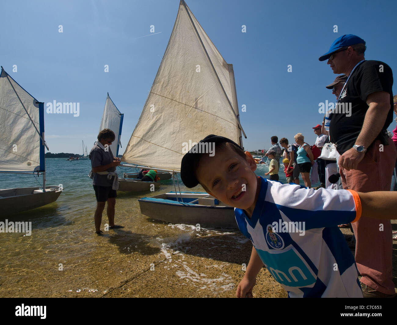 Spontaneous child, Race of little boats. Larmos Baden, Bay of Morbihan, Brittany, France, Europe. - Stock Image