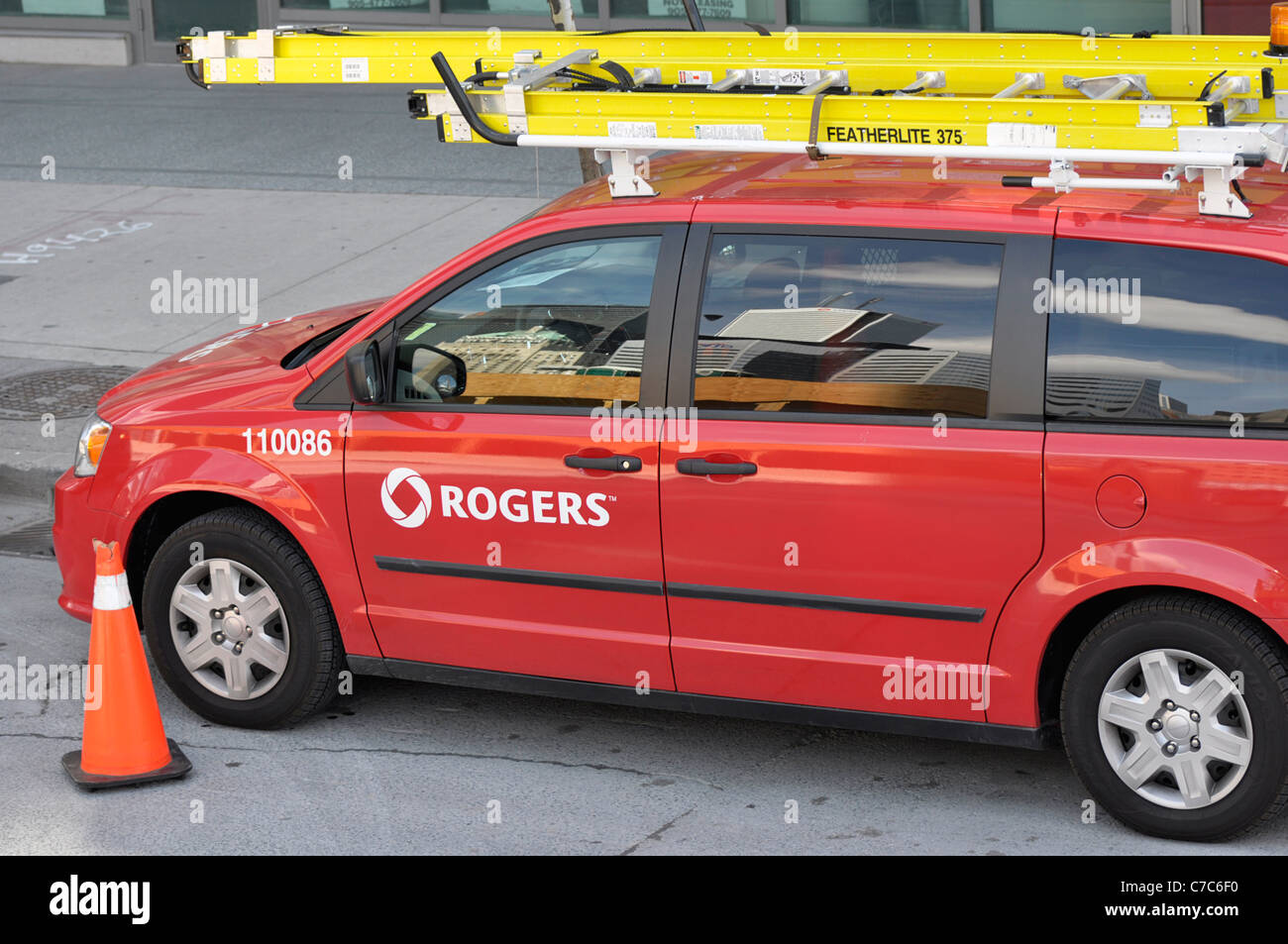 Rogers Company Van, Parked Downtown Toronto, Canada - Stock Image