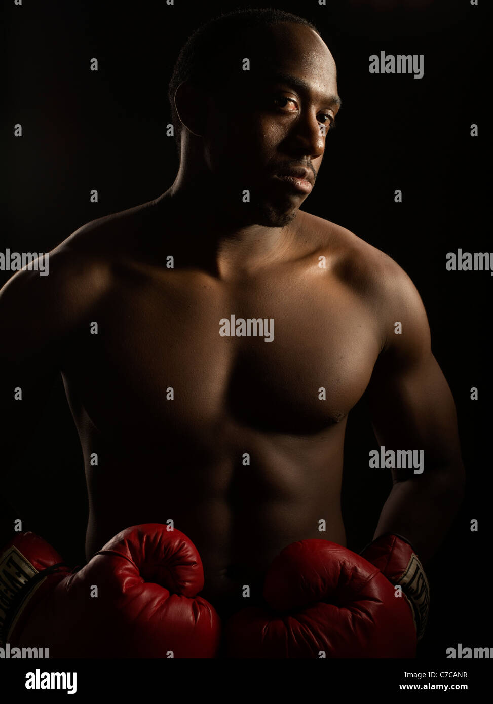 Portrait of boxer with boxing gloves - Stock Image