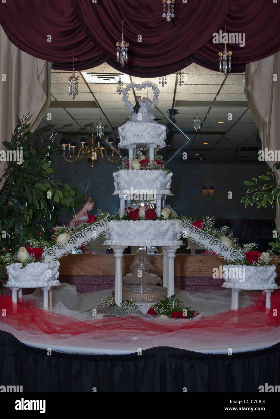 Large Multi Tiered Cake With Lit Fountain Under Neath And Bride And