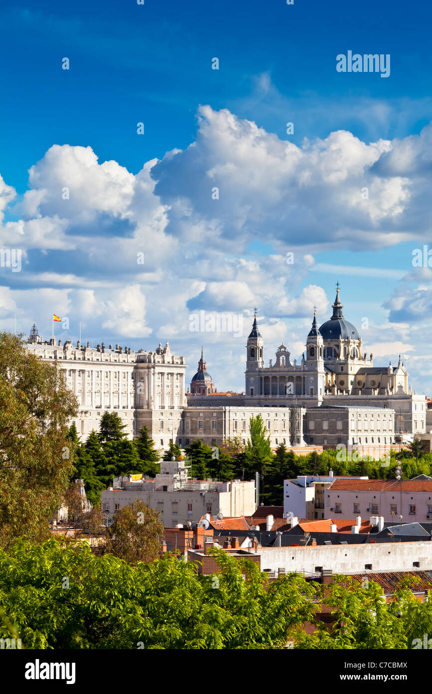 The Almudena Cathedral and the Royal Palace in Madrid, Spain. Beautiful blue sky with fluffy clouds. - Stock Image