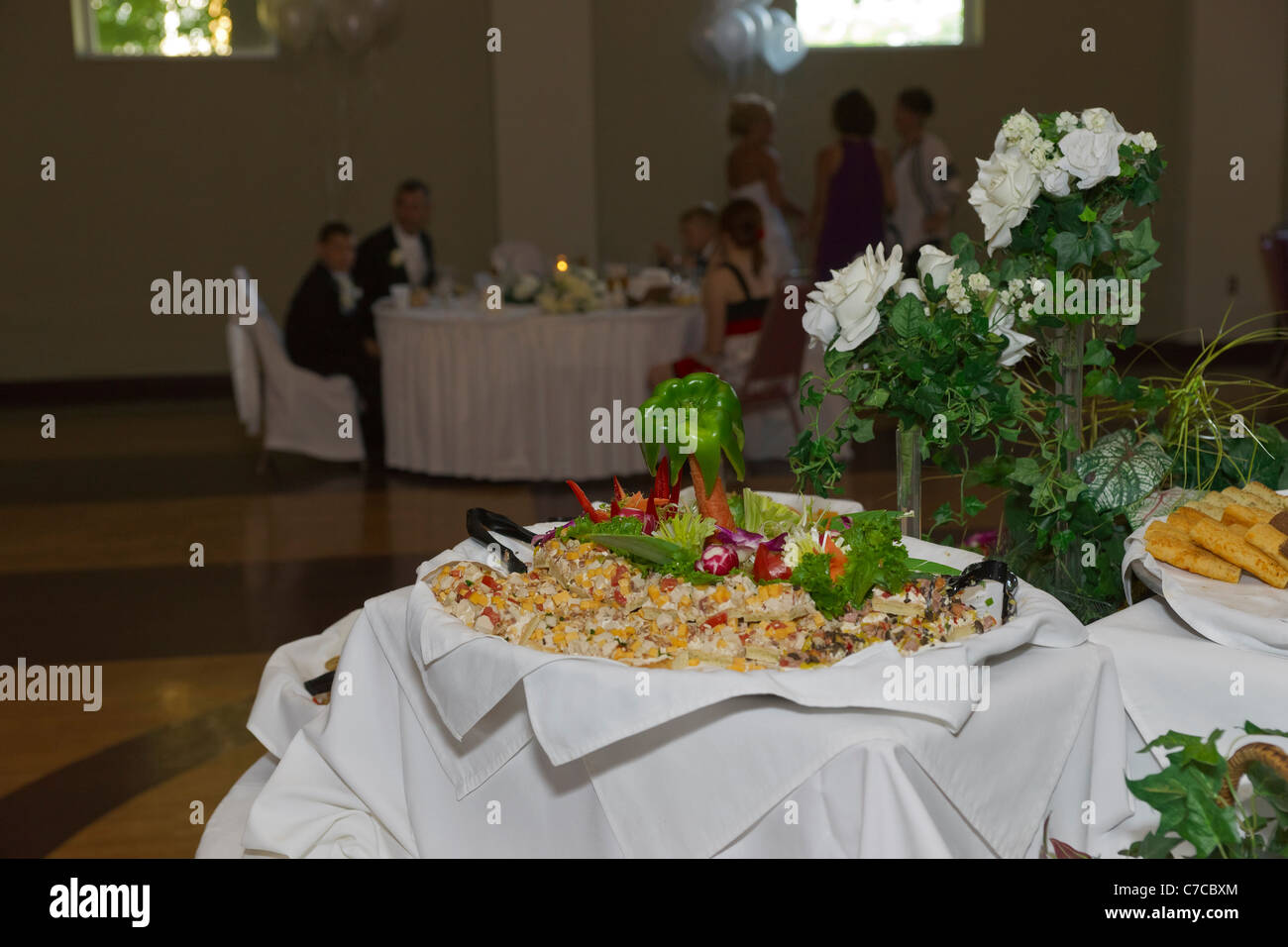 Decorative snacks buffet table set up for wedding reception with ...