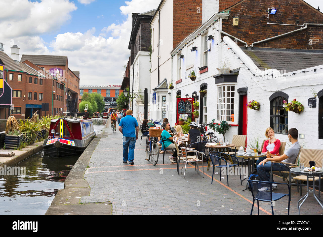 Canalside cafe at Gas Street Basin with Premier Inn and The Mailbox centre in the distance, Birmingham, West Midlands, - Stock Image