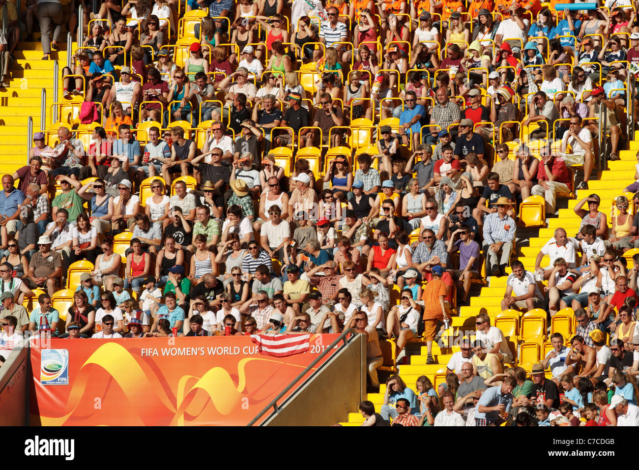 Spectators watch a 2011 Women's World Cup Group C match between the United States and North Korea in Dresden, - Stock Image