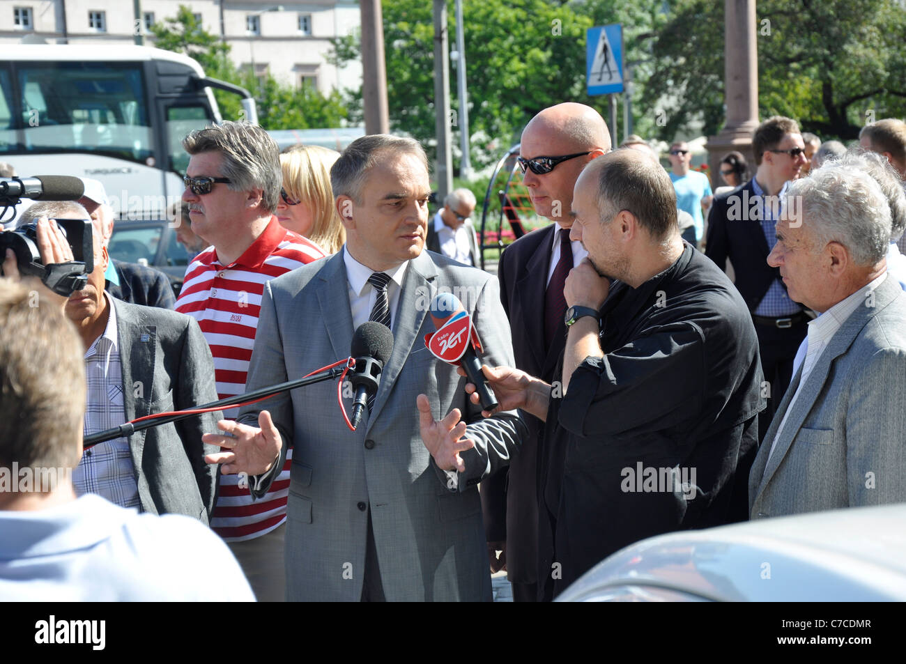 Electric cars (green eco vehicles) exhibit - Show, exhibition in Poland, Warsaw, 2011 - Waldemar Pawlak is interviewed - Stock Image