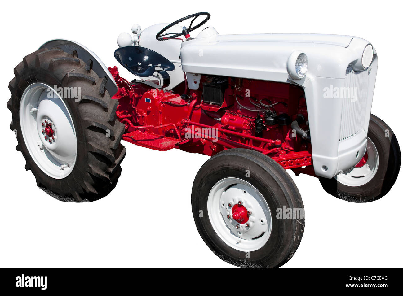 Vintage Red and White Tractor Isolated on White - Stock Image