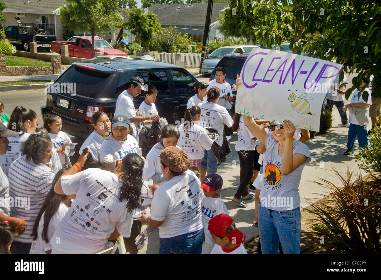 Primarily Hispanic neighborhood volunteers clean up after lunch at a civic beautification project in Santa Ana, - Stock Image