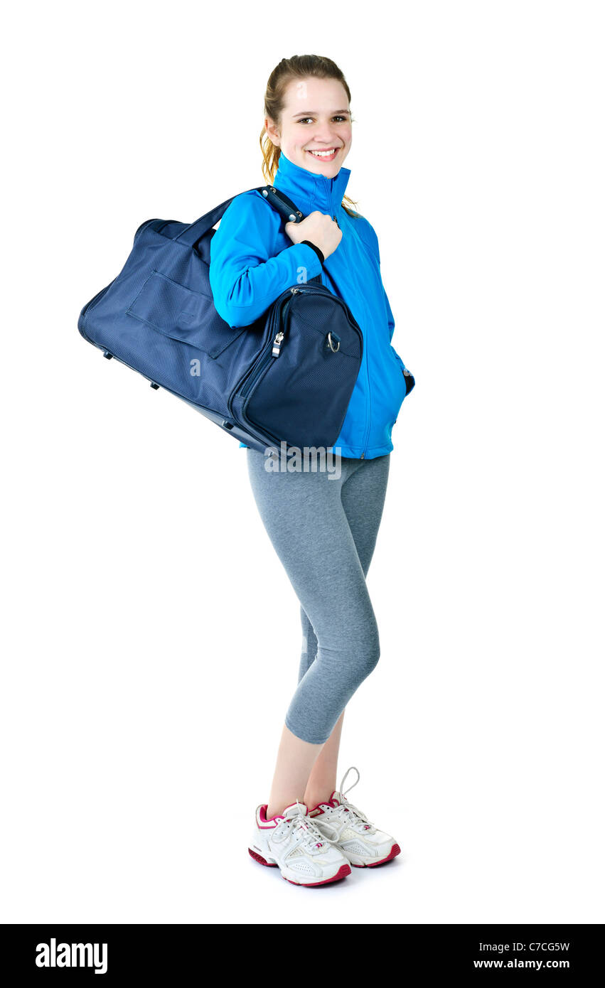 879265e6d1c7ed Happy fit young woman with gym bag standing ready for fitness exercise -  Stock Image