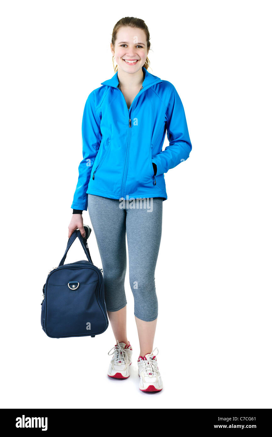 c92d477263f32c Smiling fit young woman with gym bag standing ready for fitness exercise -  Stock Image
