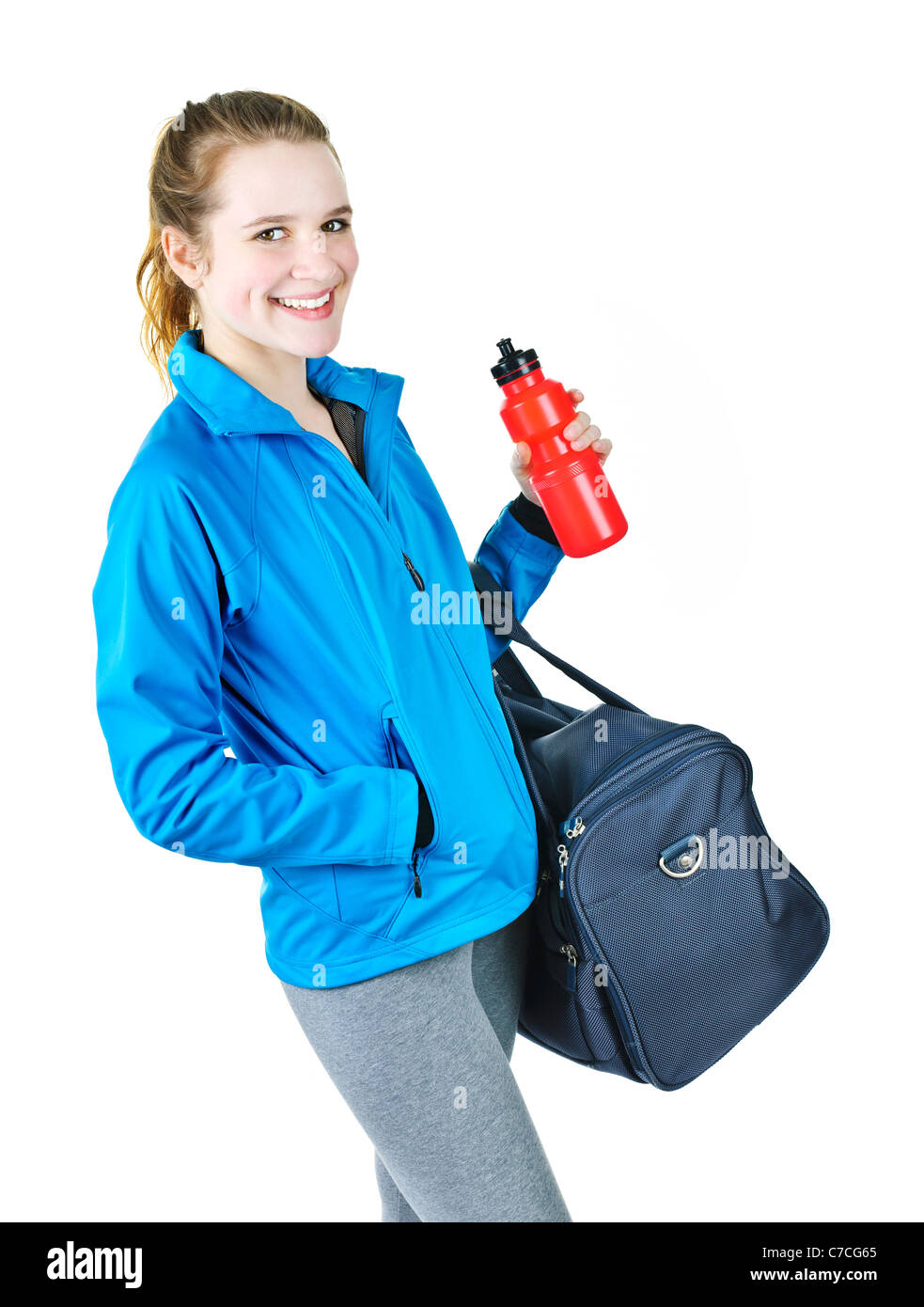01d3fbecaa39f1 Smiling fit young woman with gym bag and water bottle ready for fitness  exercise - Stock