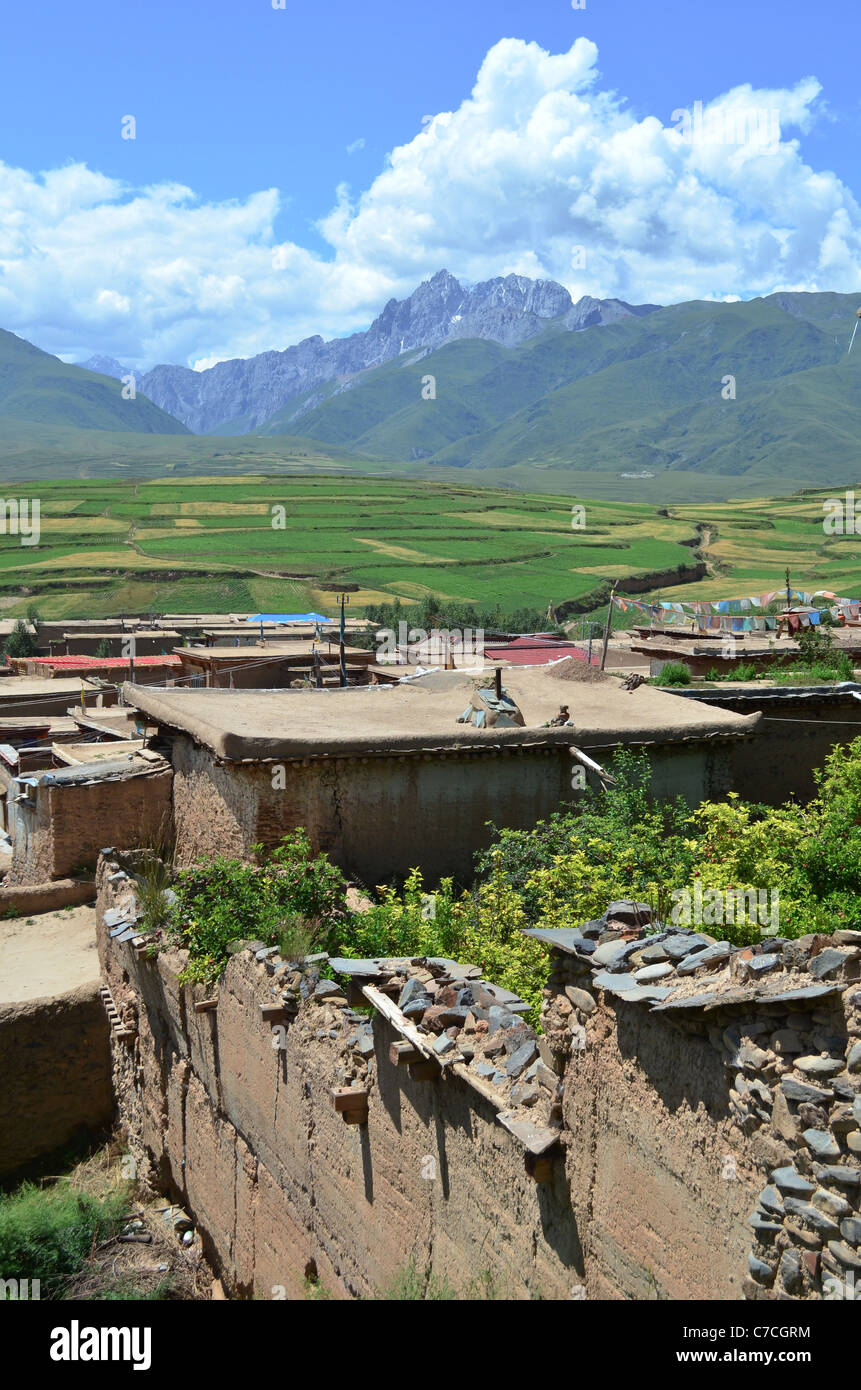 A view from the Tibetan Buddhist monastery at Ganzi, Sichuan, China, across the town to the stunning Gongga Shan - Stock Image