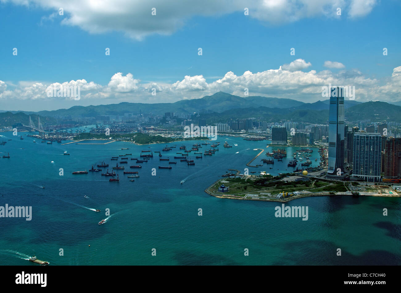 View of West Kowloon, and the International Commerce Centre (ICC), including the port area and Stonecutters Bridge. - Stock Image