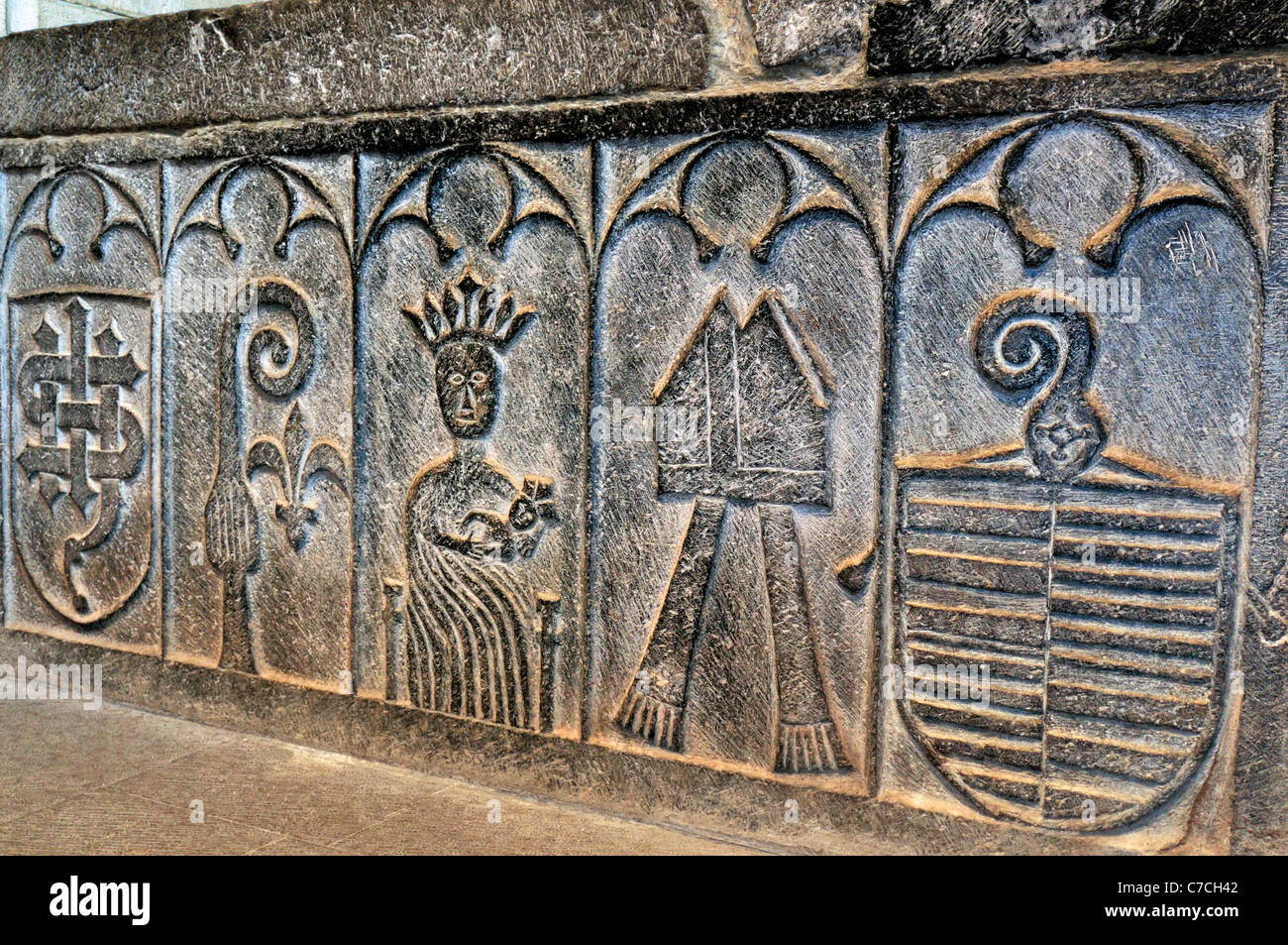 Spain, St. James Way: Romanesque stone reliefs on a tomb in the church La Colegiata in Roncesvalles - Stock Image