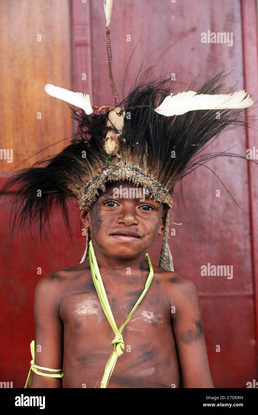young tribal boy with head dress of feathers, Papua New Guinea - Stock Image