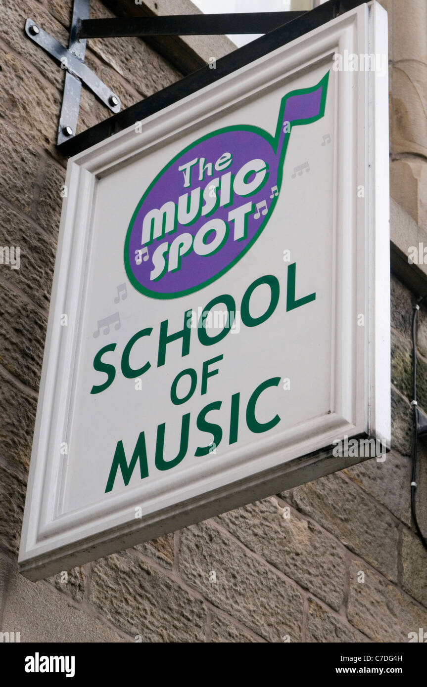 music school schools learning to play and instrument musical performing performance pupil pupils teacher teachers - Stock Image