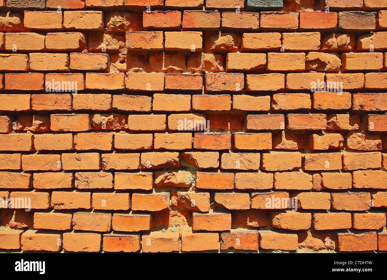 old corrupted red brick wall - Stock Image