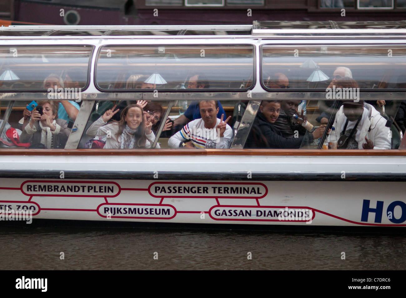 Tourist boat in Amsterdam Stock Photo