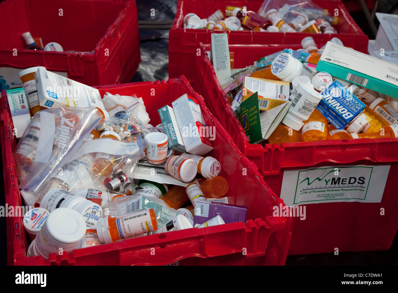 Pharmacists collect unwanted or expired prescription and over-the-counter medicines for safe disposal. - Stock Image