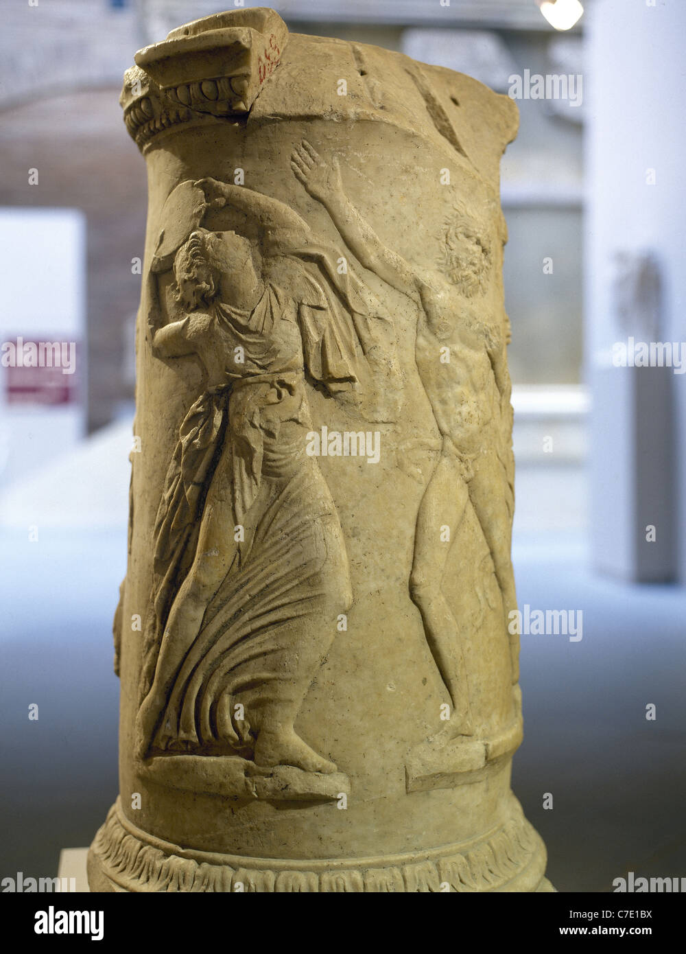 Maenad and Satyr dancing. Circular Altar. Pulpitum of the Italica Theater. 1st century. Archaeological Museum. Seville. - Stock Image